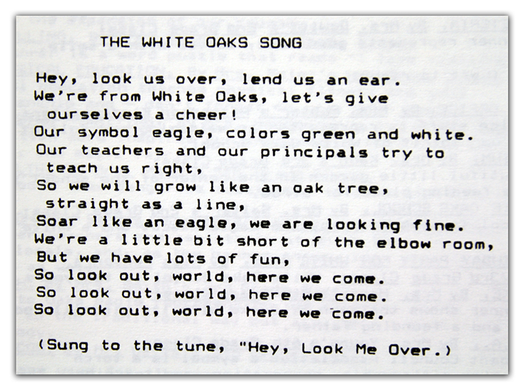 Black and white photograph of the school song lyrics from a yearbook.